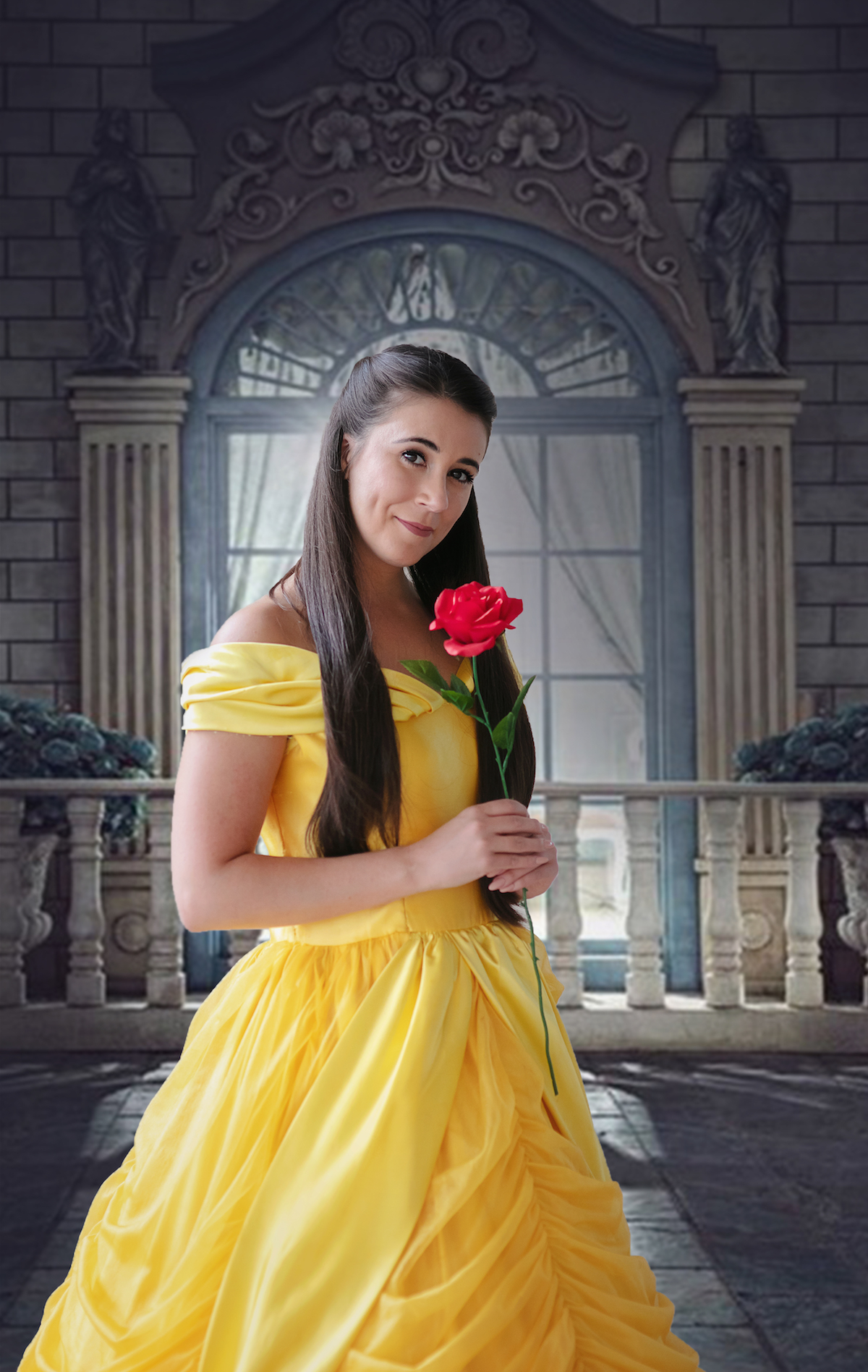 Belle from NTPA Repertory Beauty and the Beast in a yellow dress with a rose