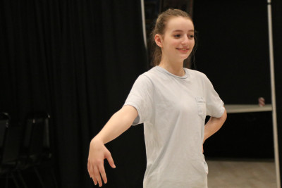 A picture of an North Texas Performing Arts student participating in a workshop class for the Academy.
