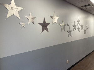 Metal stars on wall featuring names of NTPA Frisco donors
