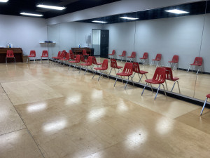 Rehearsal room with piano, wooden floors and mirrors