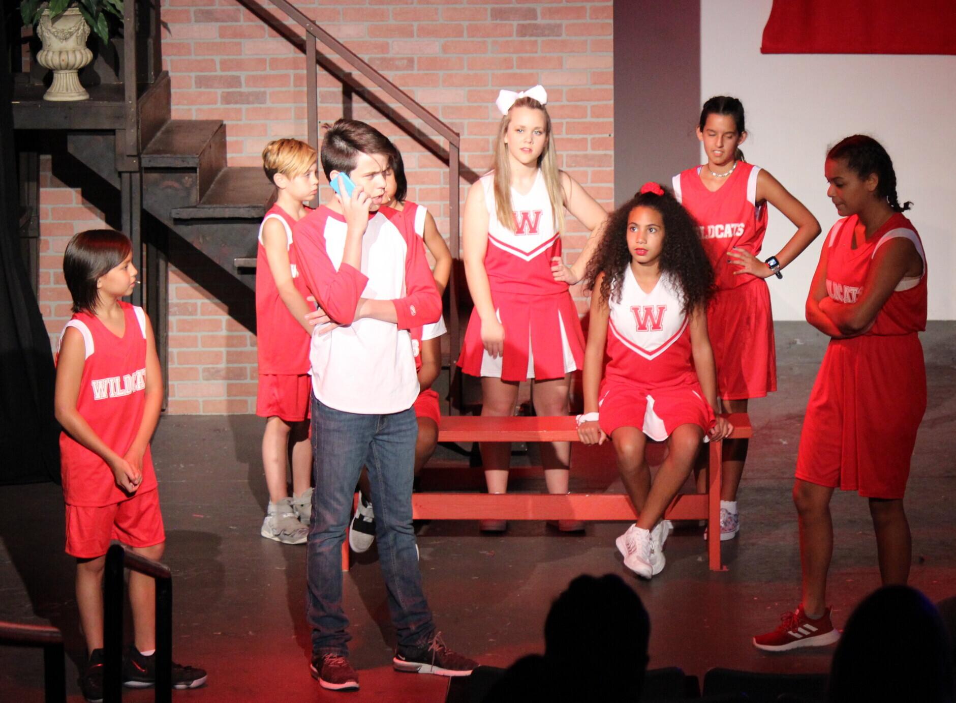 Actors performing in High School Musical JR