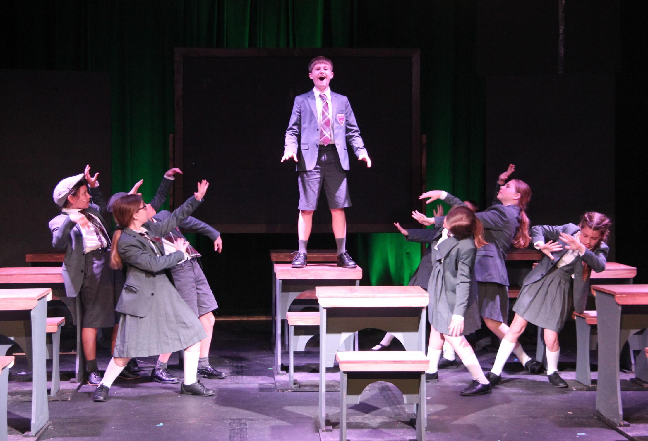 Actors performing Revolting Children in Matilda